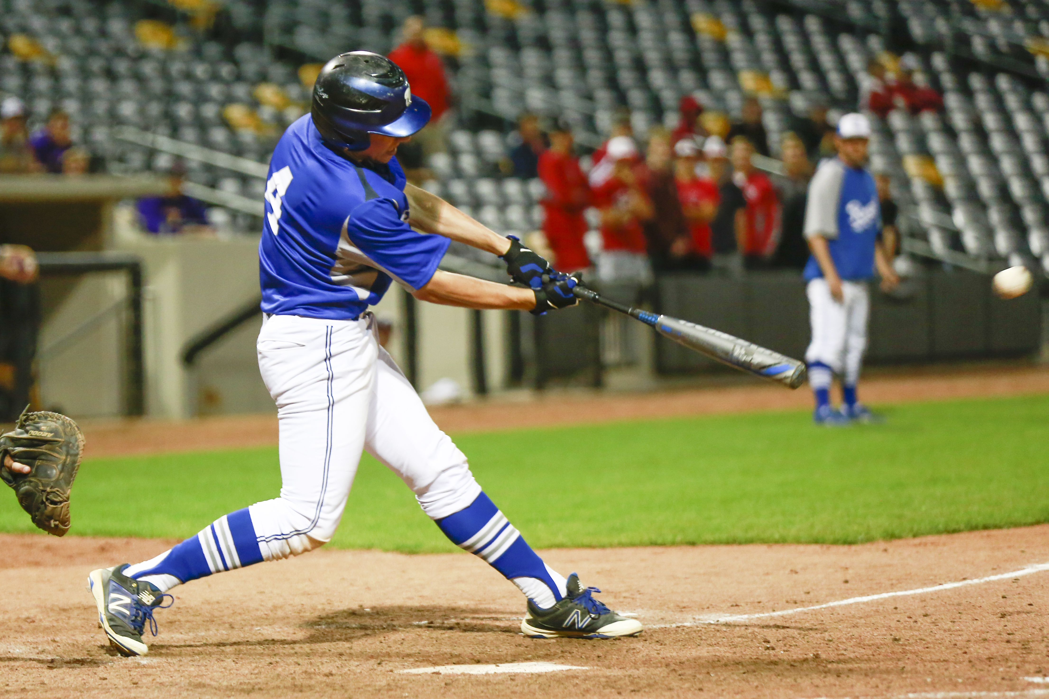 Woodbury junior Nolan Glunz (4) comes through with the game-winning hit against Stillwater in the Class 4A, Section 4 championship game Tuesday night at CHS Field in St. Paul. The Royals won 3-2 in 10 innings. Photo by Chris Juhn