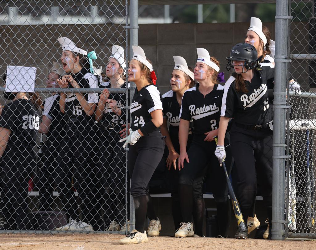 East Ridge's Emma Spuhler catches the ball over the left field fence to stop a third home-run in the game for Stillwater.  The Raptor's, ranked 10th, fell 3-1 to the top-ranked Ponies at Stillwater High School. Photo by Cheryl A. Myers