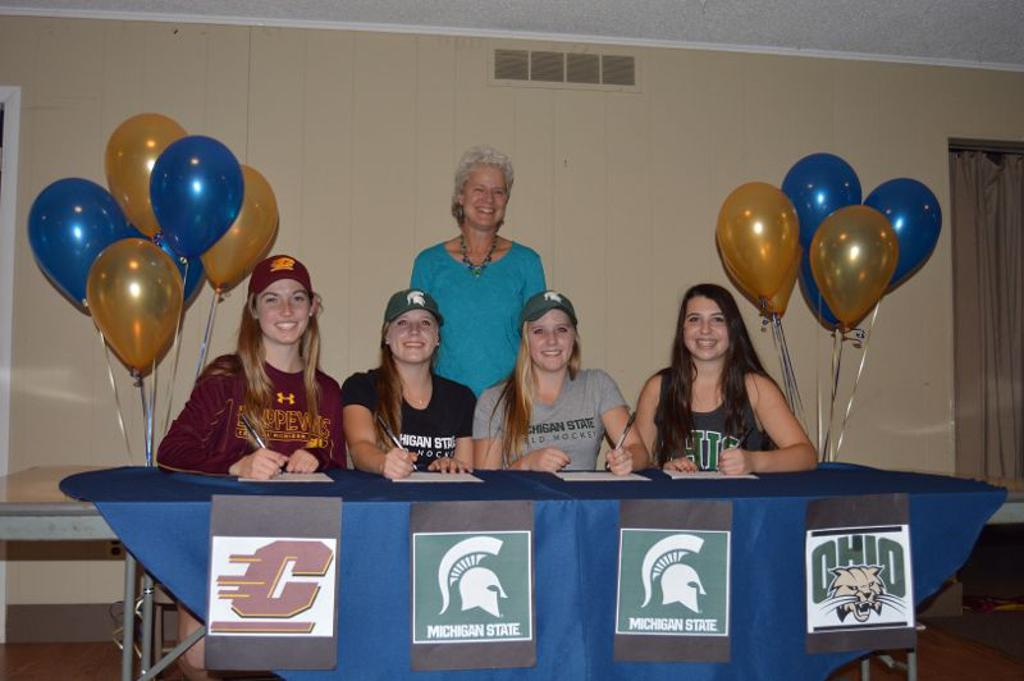 Four athletes sign to play with D1 universities