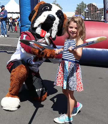 Girls and boys of all ages learned the basics of street hockey from several Avalanche alumni and even team mascot Bernie. Photo courtesy of the Colorado Avalanche