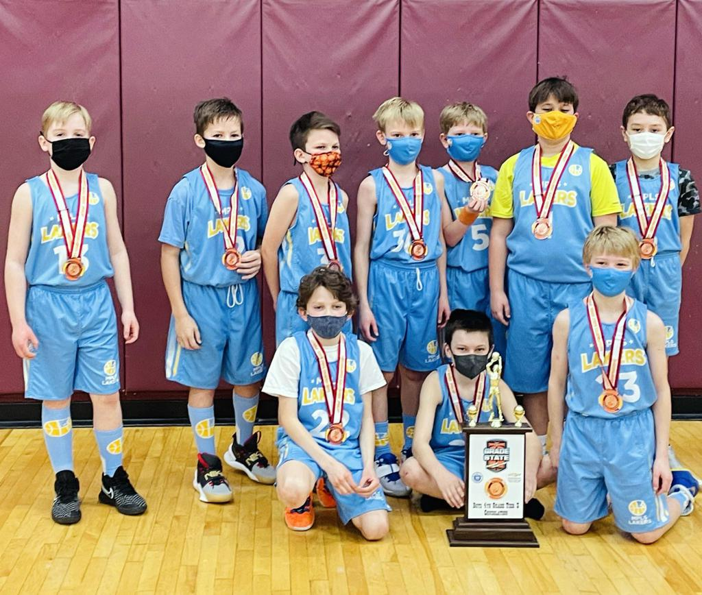 Mpls Lakers Youth Traveling Basketball Program Inc Boys 4th Grade Gold pose after winning the Consolation Bracket at MYAS Grade State year end tournament