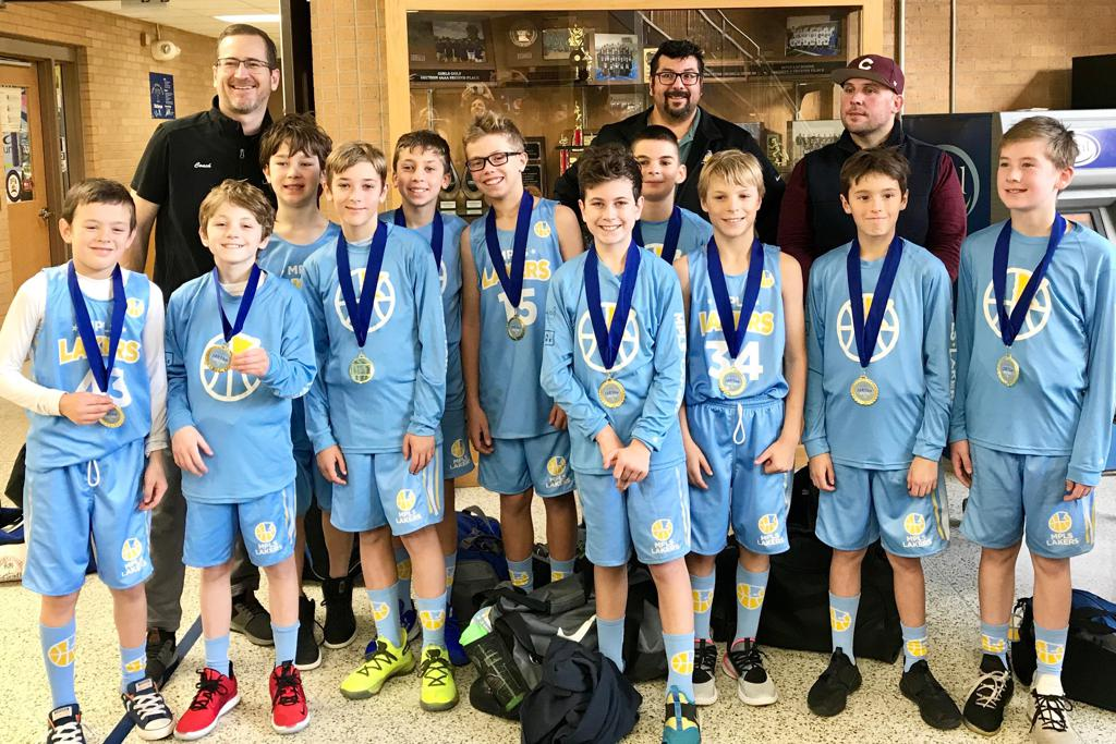 Minneapolis Lakers Boys 5th Grade White pose with their Medals after becoming the Champions at the Tartan Tip Off tournament in Oakdale, MN