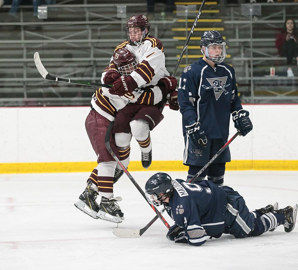 South St. Paul's Jacob Saver and Jayce Schauer (19) celebrate Schauer's third-period goal. Saver, wearing the retired jersey of former Packers player and coach Doug Woog, scored the tying goal late in regulation. Photo by Cheryl A, Myers, SportsEngine