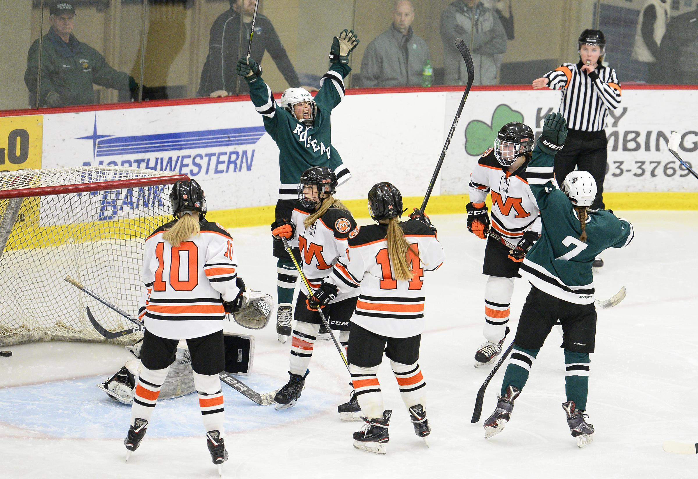 Roseau's Brooke Zagone (5) and Ella Helgeson (7) celebrate a second-period goal in the Rams' 6-0 victory at Moorhead Tuesday night. Photo by Tim Kolehmainen, SportsEngine