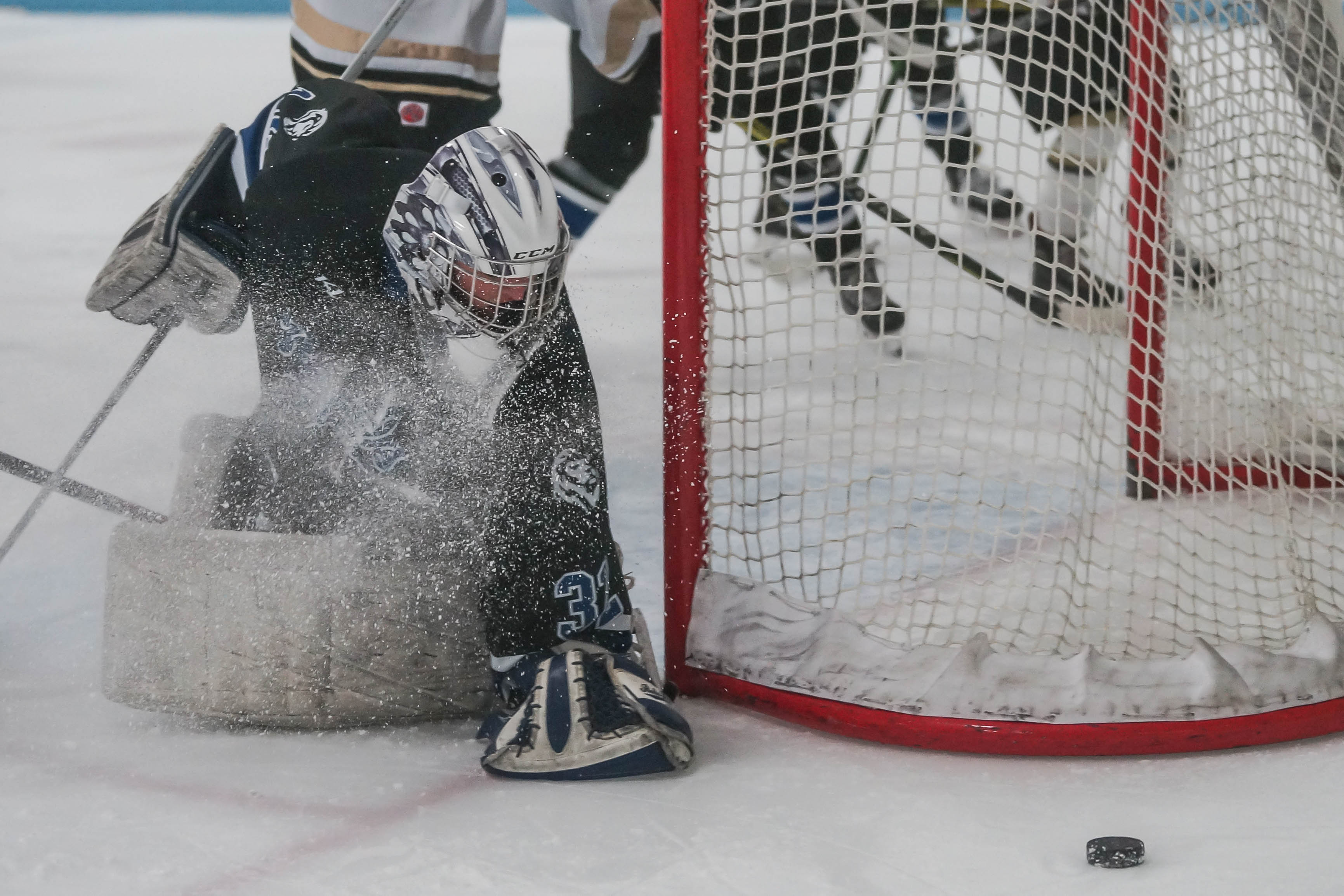 Royals goalie Anna Julius searches for a loose puck during play against East Ridge on Jan 4. Photo by Korey McDermott, SportEngine