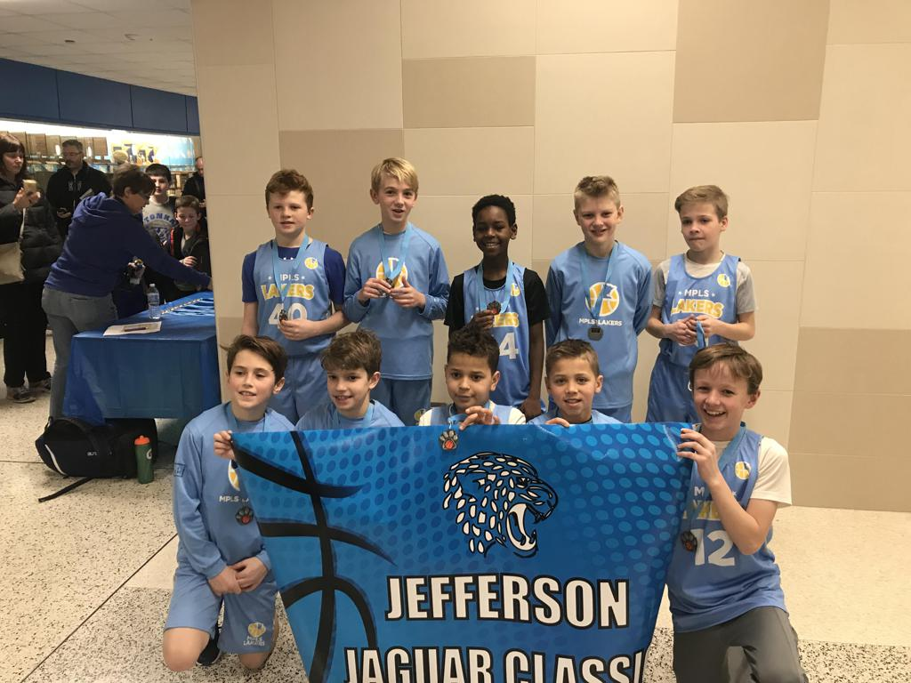 Minneapolis Lakers Boys 5th Grade Gold pose with their second place medals at the Jefferson Jaguar Classic in Bloomington, MN