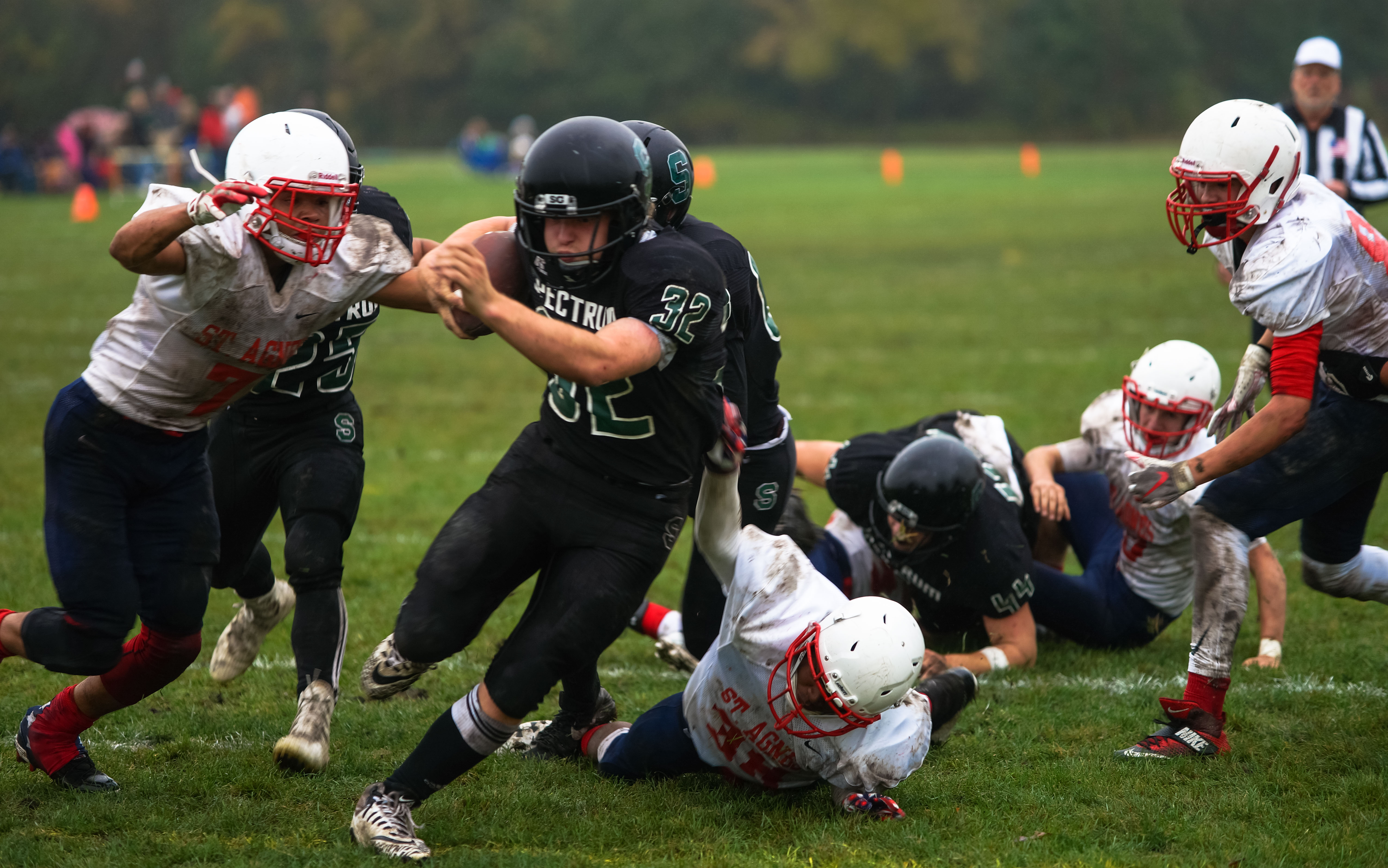 Spectrum's Fisher Marberg (32) fights off St. Agnes defenders during a 2nd quarter touchdown run on Oct. 5. Photo by Korey McDermott, SportsEngine