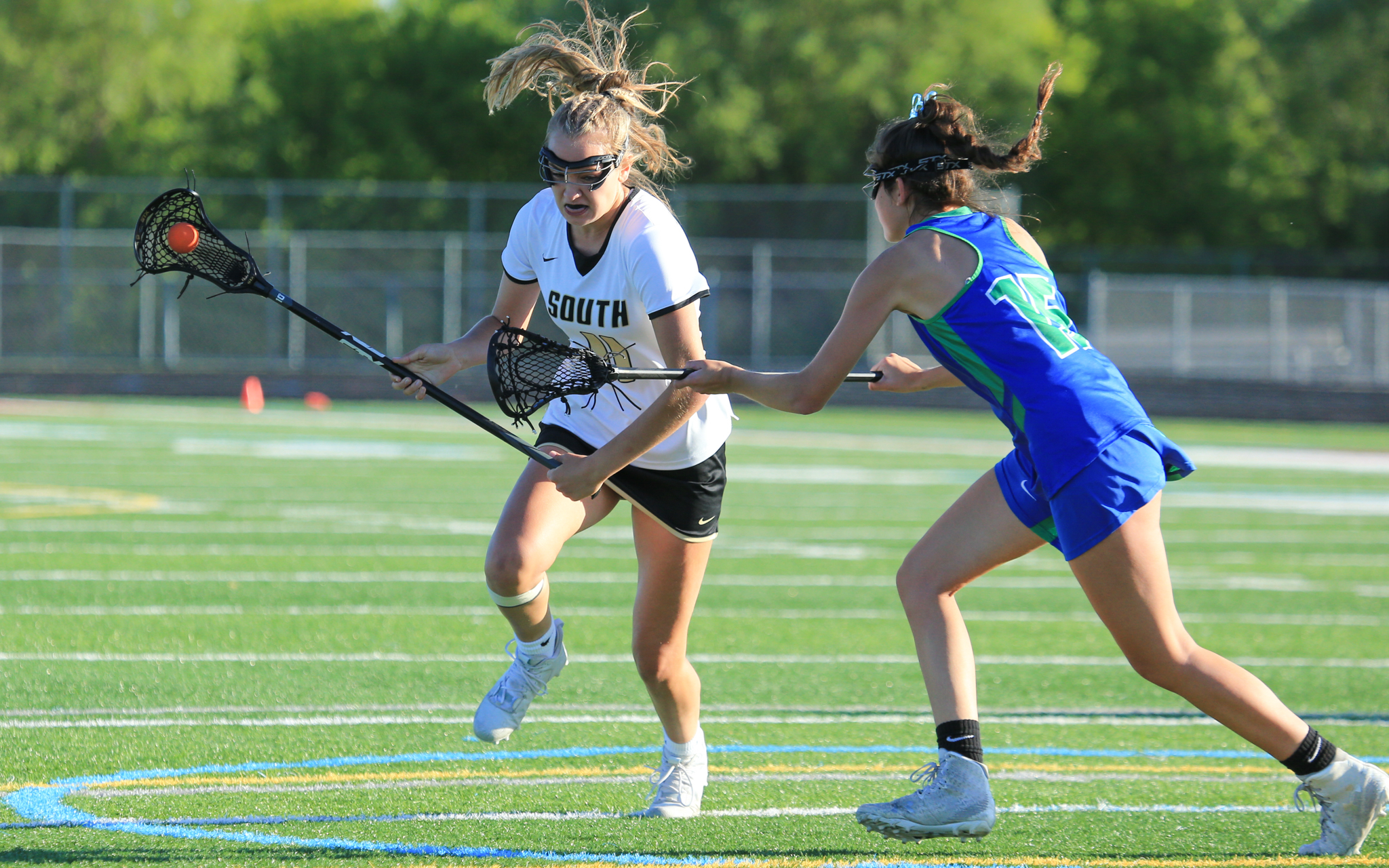 Lakeville South's Emily Moes (11) scored a game-high seven goals in a nonconference matchup against Blake Friday evening. The Cougars defeated the visiting Bears 15-13. Photo by Jeff Lawler, SportsEngine