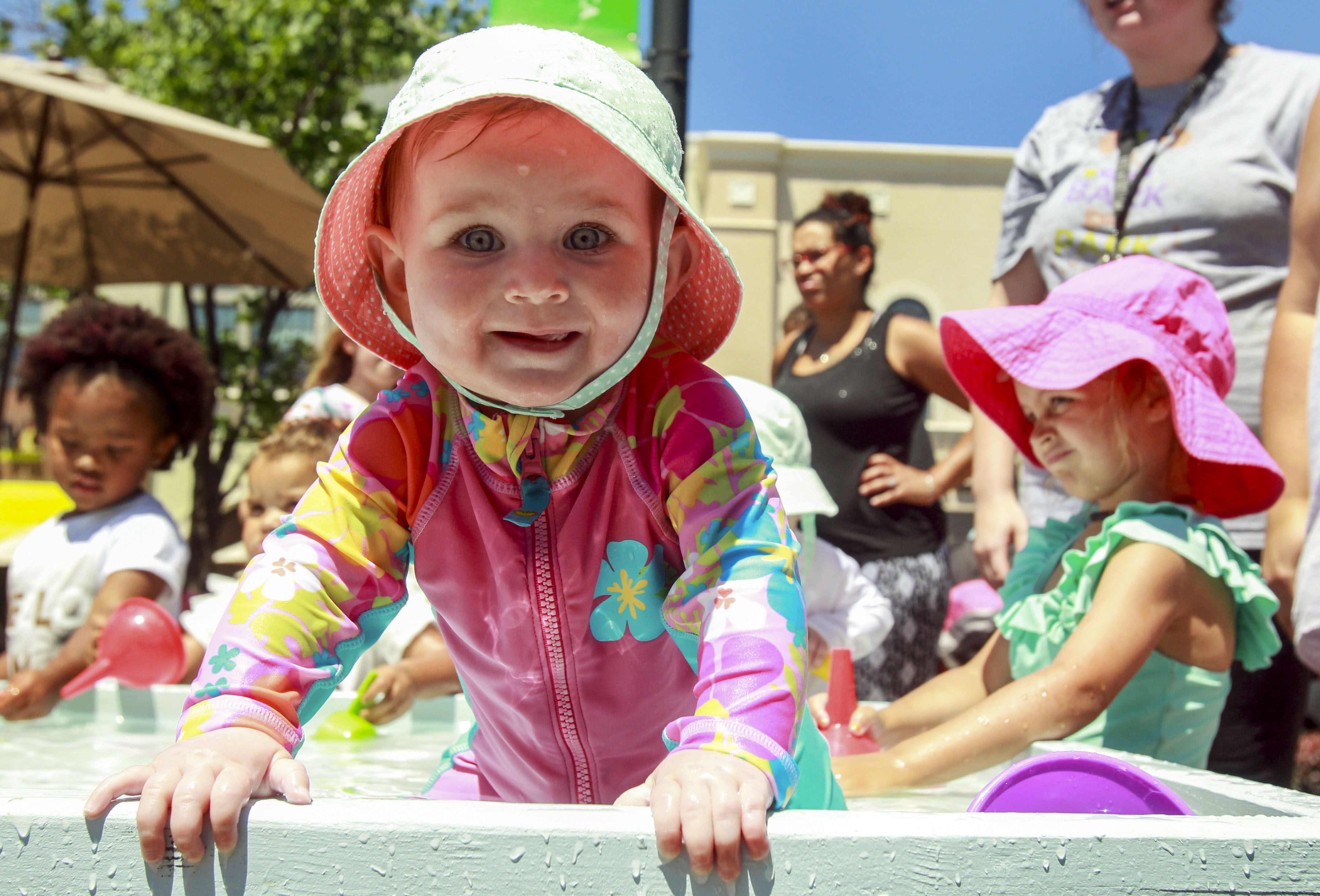 pictures of the week 20 26 2016 breah romard 9 months of toledo sits in a fountain during sand tastic at the town center at levi commons in perrysburg ohio friday 24 2016