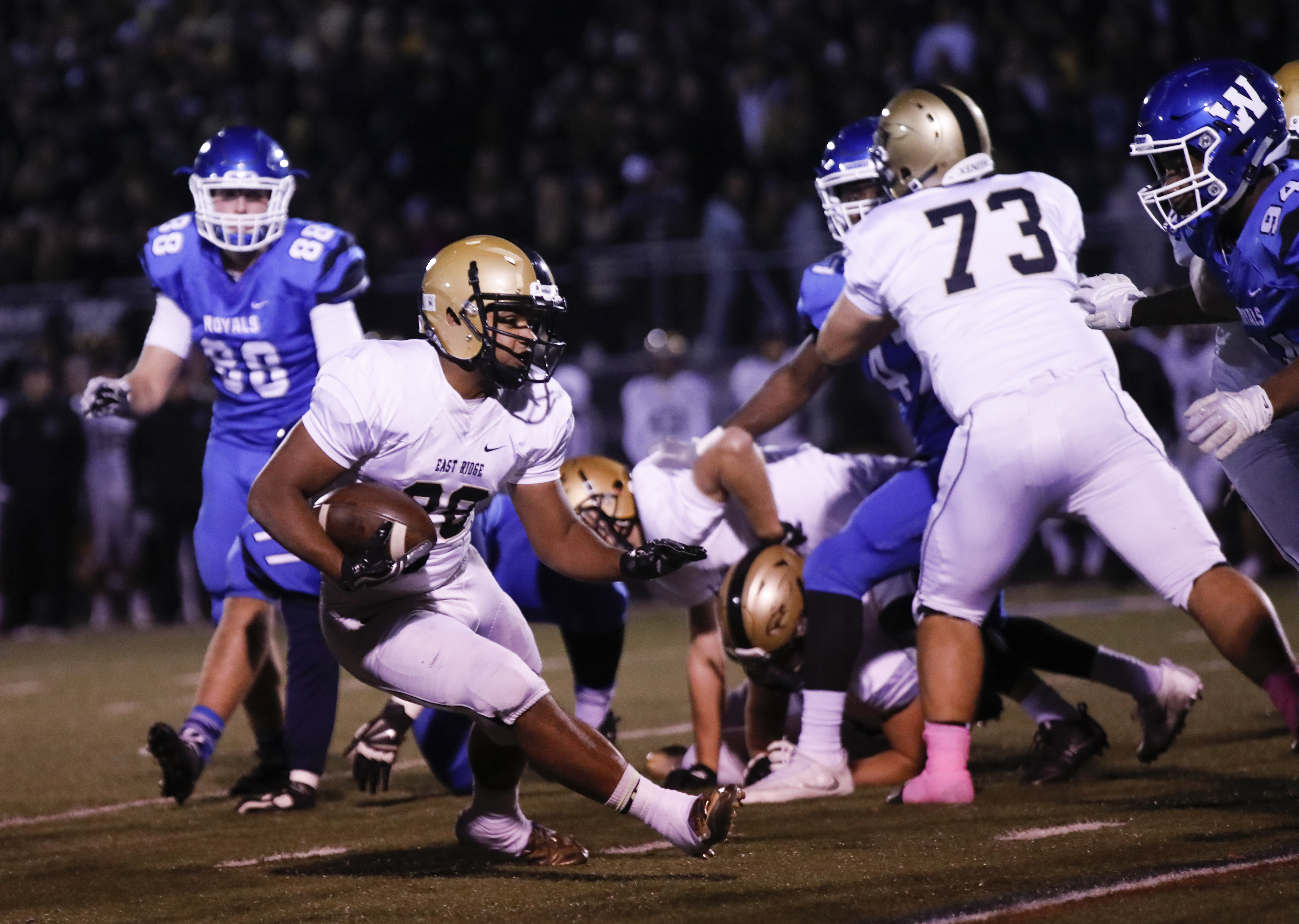 Dominik London (28) of East Ridge runs the ball up the field. East Ridge lost to its rival Woodbury 47-25 in a game at Woodbury. Photo by Chris Juhn