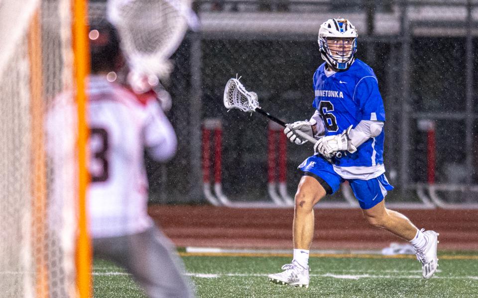 Minnetonka's Isaac Forst (6) had five goals on a rainy Tuesday night in the Skippers' 10-4 win over the Eagles in Eden Prairie. Photo by Earl J. Ebensteiner, SportsEngine