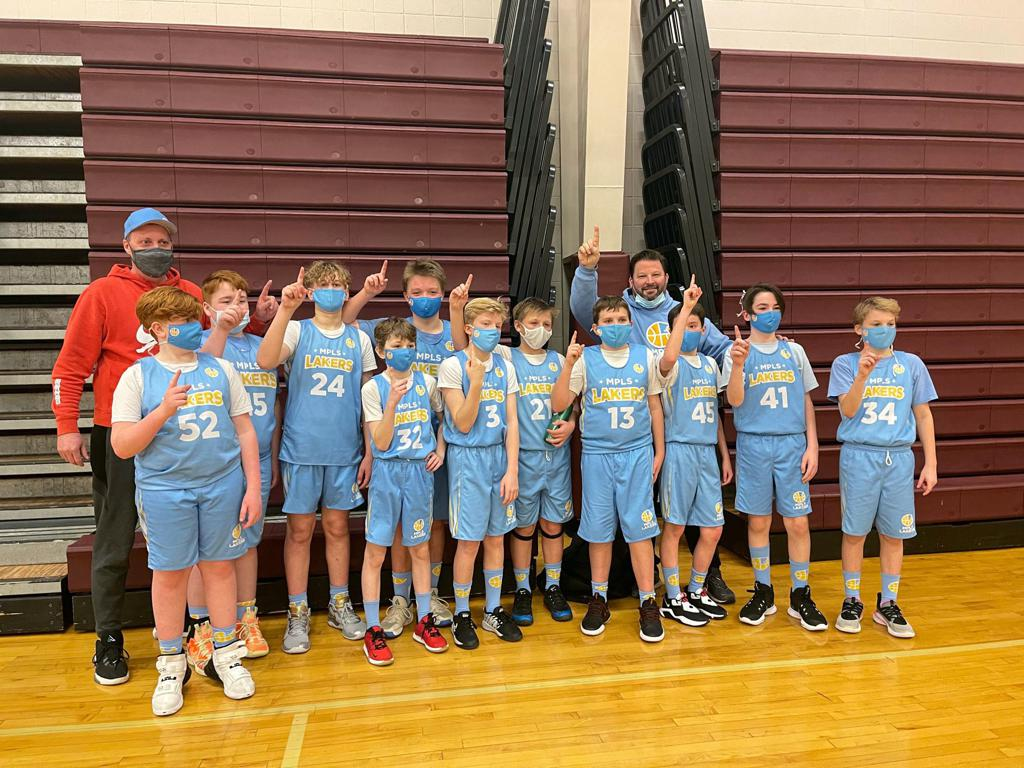 Mpls Lakers Youth Traveling Basketball Program Inc Boys 6th Grade White pose after becoming the Champions at the Forest Lake Border Battle in Forest Lake, MN