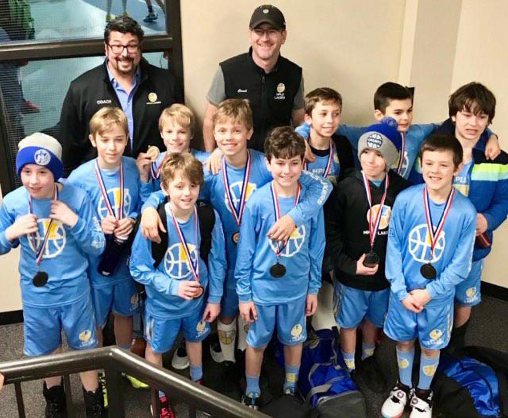 Minneapolis Lakers Boys 5th Grade White pose with their medals after earning 2nd place at the Concordia Golden Bears Classic Tournament in St Paul, MN