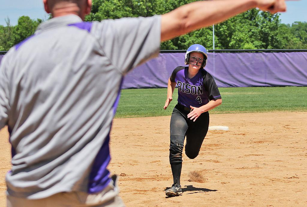 Katie Carlson heads to third and is signaled home for the walk-off run. Buffalo survived a seventh inning rally to defeat Brainerd 4-3 in the Class 4A, Section 8 final at Buffalo High School. Photo by Cheryl Myers, SportsEngine