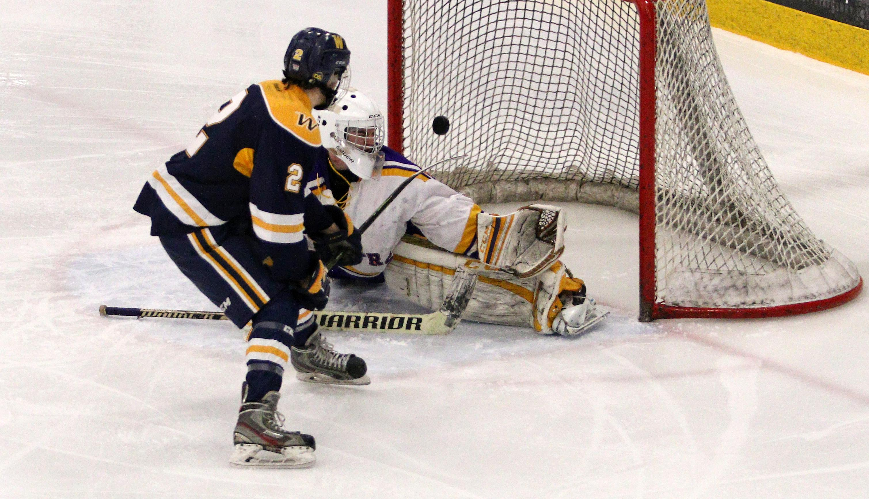 Andrew Urban scores off his backhand to give Wayzata a 2-0 lead early in the third period.  The Trojans would add a pair of empty net goals later in the period to defeat the Raiders 4-0.  Photo by Cheryl Myers, SportsEngine