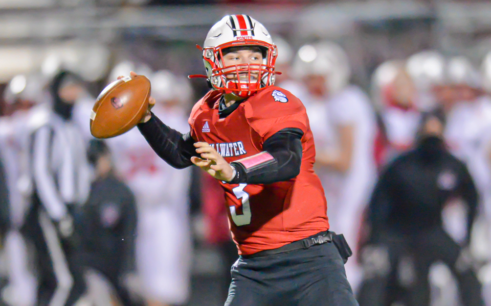 Stillwater quarterback Casey Venske looks deep for a receiver late in the fourth quarter. The Ponies lost to the Cougars 27-14 Friday night in a Class 6A section championship game. Photo by Earl J. Ebensteiner, SportsEngine