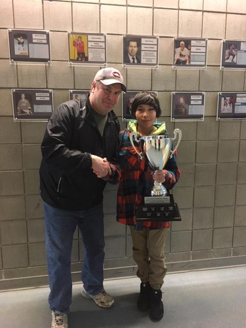 Dave Johnstone - Bantam Director presenting Jada Bull with the Ted Larson Memorial Award - Most sportsmanlike in Bantam House League.