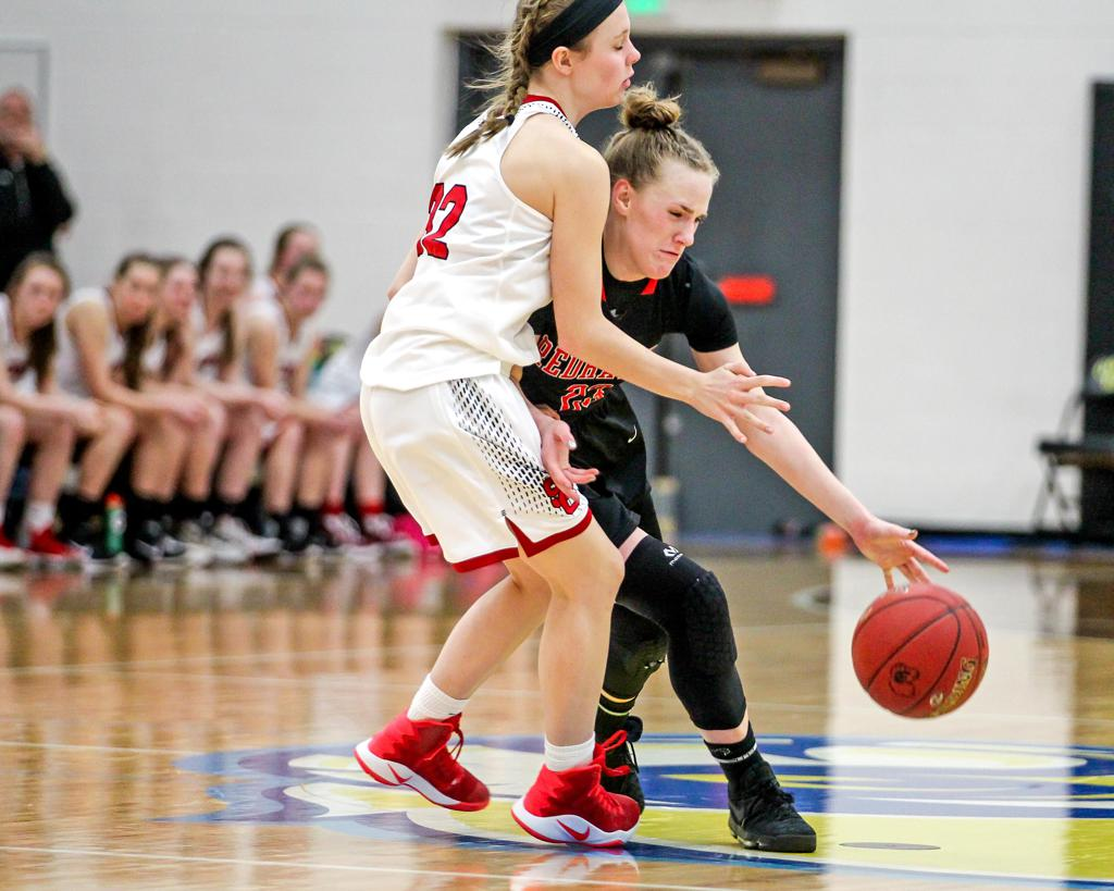 Minnehaha Academy's Terra Rhoades, right, collides with St. Croix Lutheran defender Kenna Moon. Rhoades scored 15 points to lead Minnehaha Academy to a victory in the Class 2A Section 4 final. Photo by Mark Hvidsten, SportsEngine