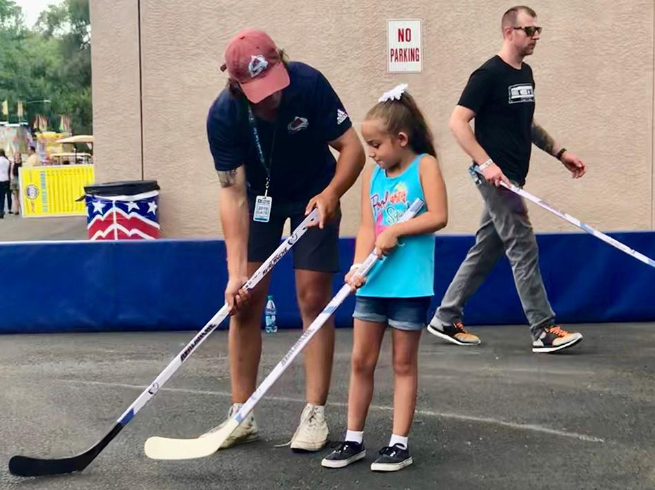 Learning to properly hold a hockey stick is one part of the Game On initiative. Photo courtesy of the Colorado Avalanche