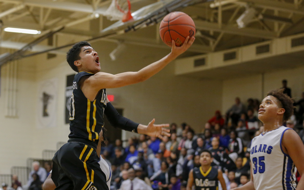 DeLaSalle's Tyrell Terry goes in for a layup against Minneapolis North. Terry had a game-high 23 points in the Islanders' 66-57 victory over the Polars Tuesday night in Minneapolis. Photo by Jeff Lawler, SportsEngine