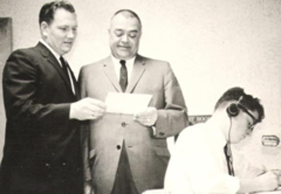 Ed and Eugene Granse holding broadcast license