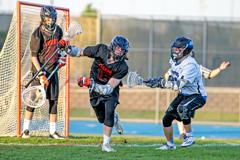 Eastview's Noah Lindell (right) puts pressure on Farmington's Tyler Wenck (16). Photo by Mark Hvidsten, SportsEngine