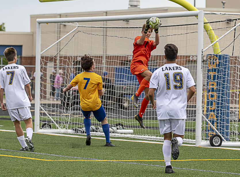 Prior Lake Junior goalie Griffin Frum makes a save against Wayzata Saturday afternoon at Wayzata High School. Photo by Gary Mukai, SportsEngine