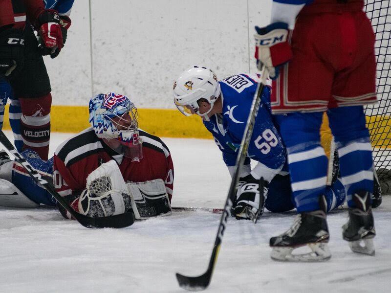 NHL Stanley Cup Champion Jake Guentzel pops in for a quick hello with Velocity netminder Charlie Lindgren. Credit: Spencer St. Dennis.