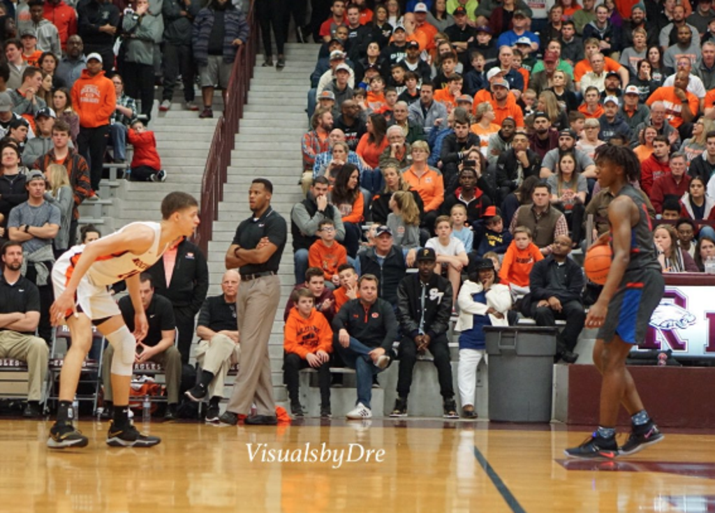Samuell Williamson (left) and Tyrese Maxey (right) go head to head. Photo by @visualsbydre