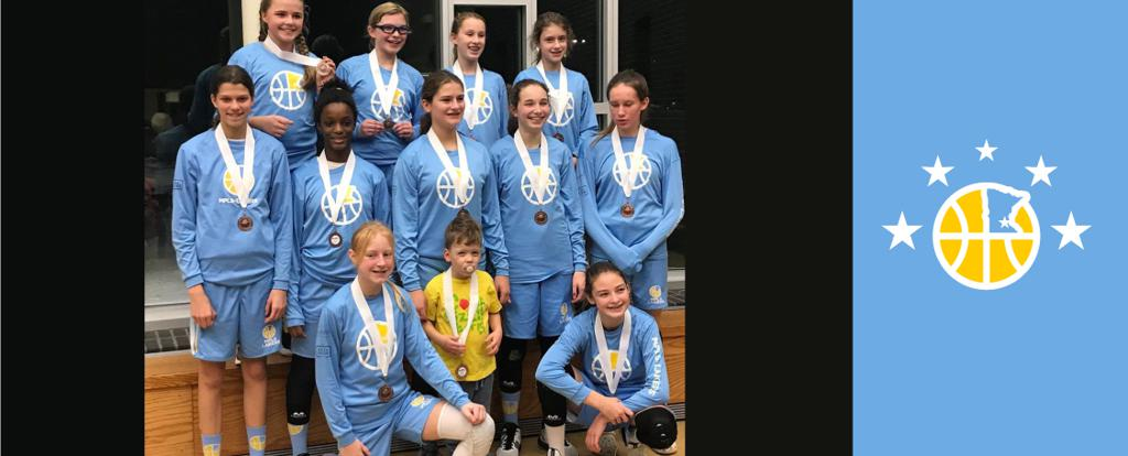 Minneapolis Lakers Girls 7th Grade Gold pose with their medals after earning 3rd place at the Rockford Girls Showcase tournament in Rockford, MN