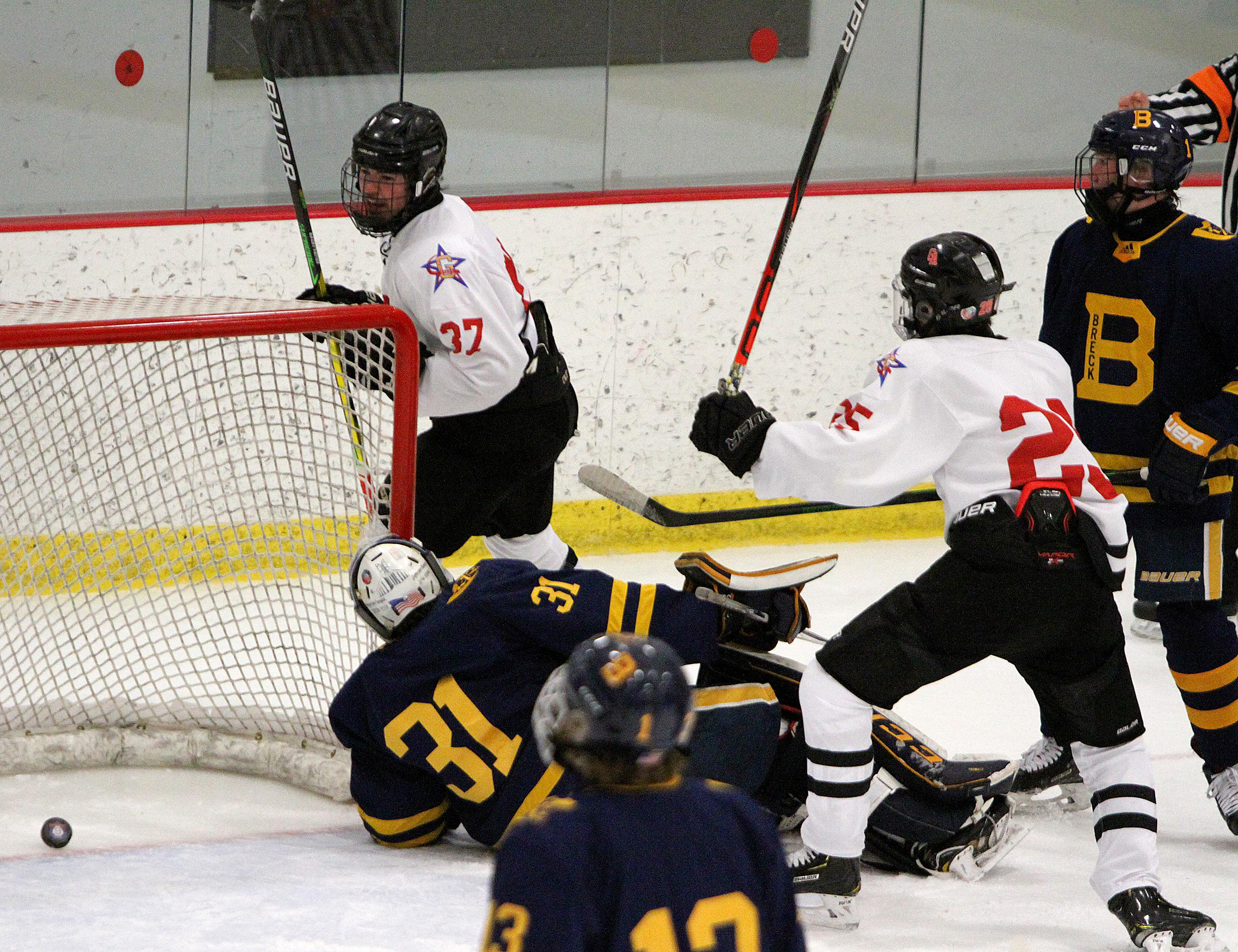 Gentry Academy senior wing Andrew Mosley scores a first-period goal as the Stars seized control of the game early. Mosley was one of six forwards on the top three lines making their varsity debut. Photo by Drew Herron, SportsEngine