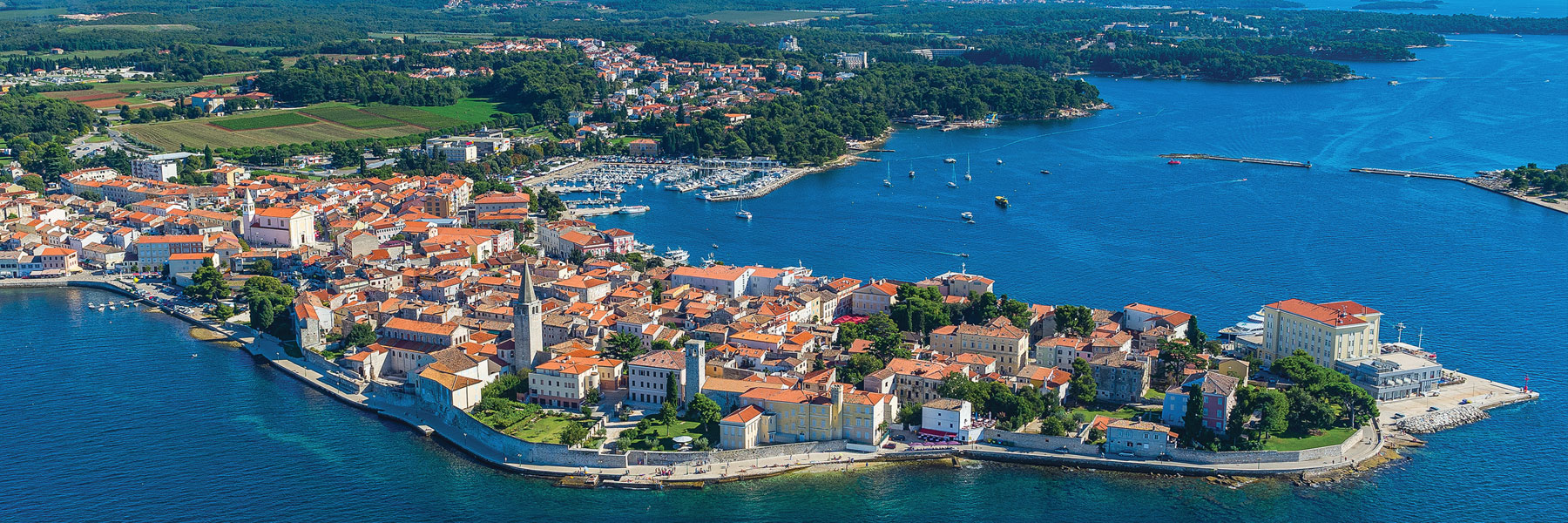 Bird's eye view of the city of Porec, which is set around a harbour protected from the crystal clear sea