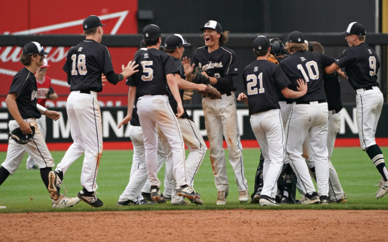East Ridge players celebrate defeating rival Stillwater in a Class 4A semifinal last June. The Raptors went on to win their first state championship. Photo by Shari L. Gross, Star Tribune