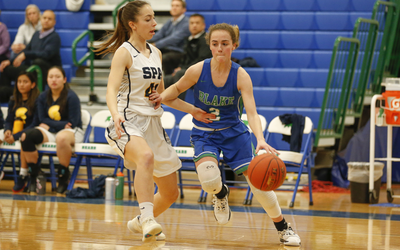 Blake's Rachel Winkey (2) looks for room along the baseline as St. Paul Academy's Julia Baron (41) defends. Winkey had three points and seven assists in the Bears' 68-39 victory over the Spartans. Photo by Jeff Lawler, SportsEngine