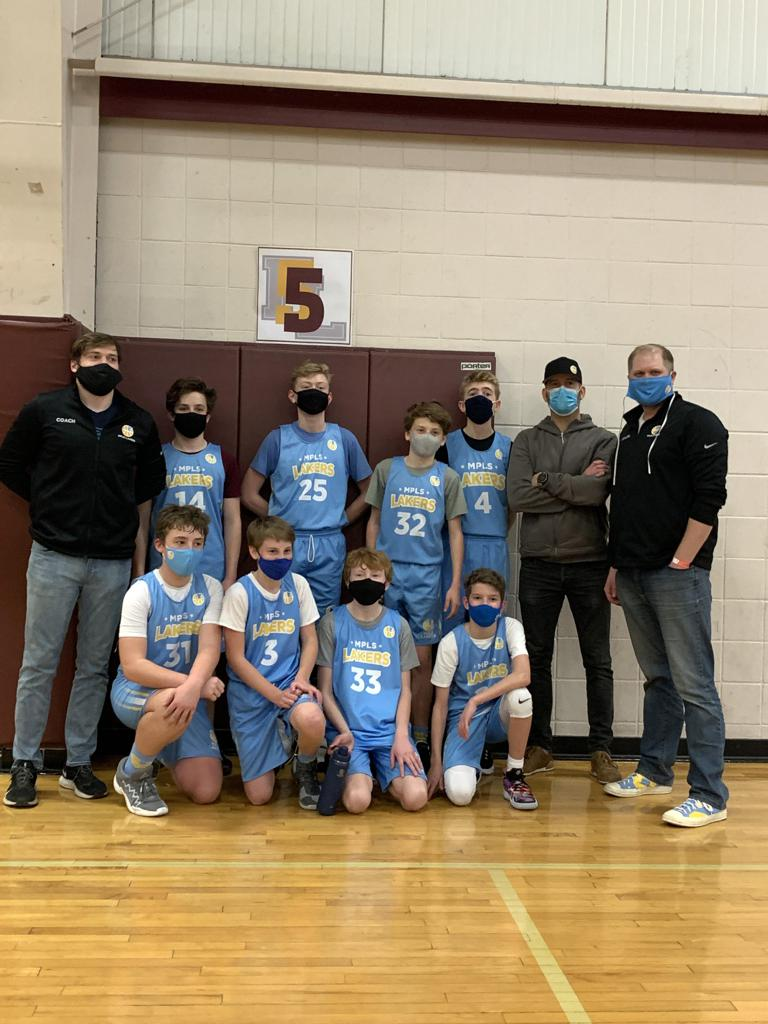 Mpls Lakers Youth Traveling Basketball Program Inc Boys 7th Grade Blue pose after becoming the Champions at the Forest Lake Border Battle in Forest lake, MN