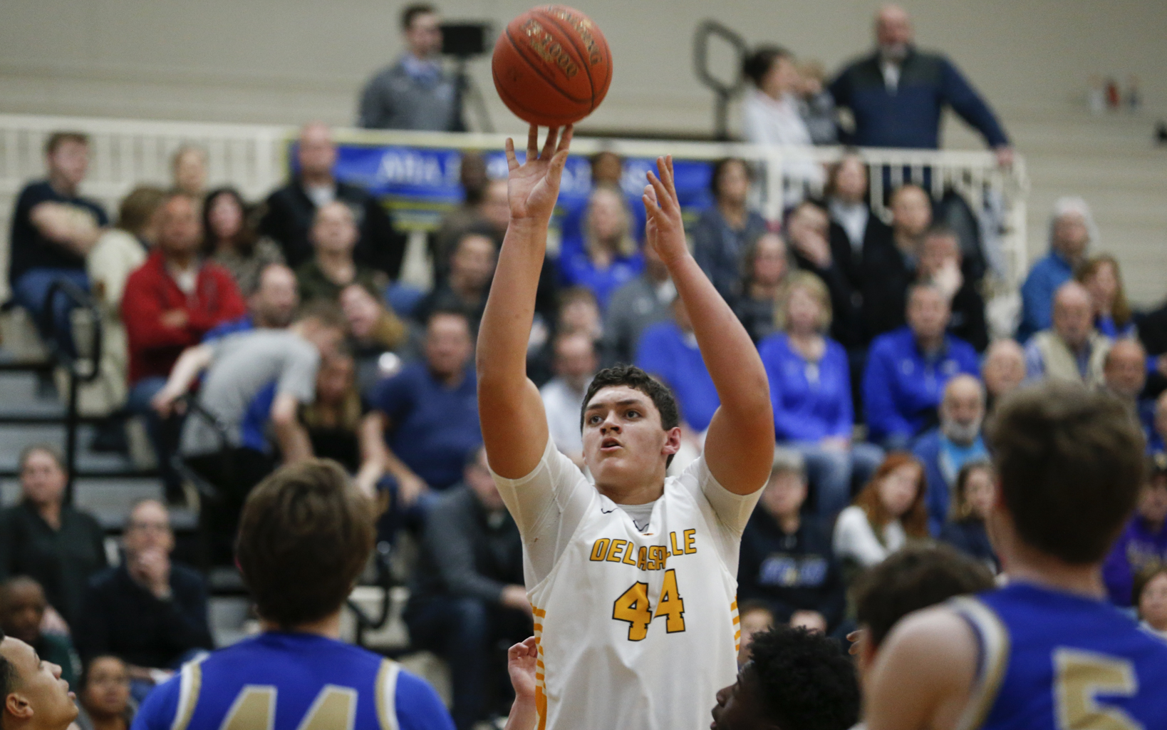 DeLaSalle's Jalen Travis (44) puts up a shot against Holy Angels Friday night. Travis had 12 points in the Islanders' 59-56 victory over the Stars in Richfield. Photo by Jeff Lawler, SportsEngine