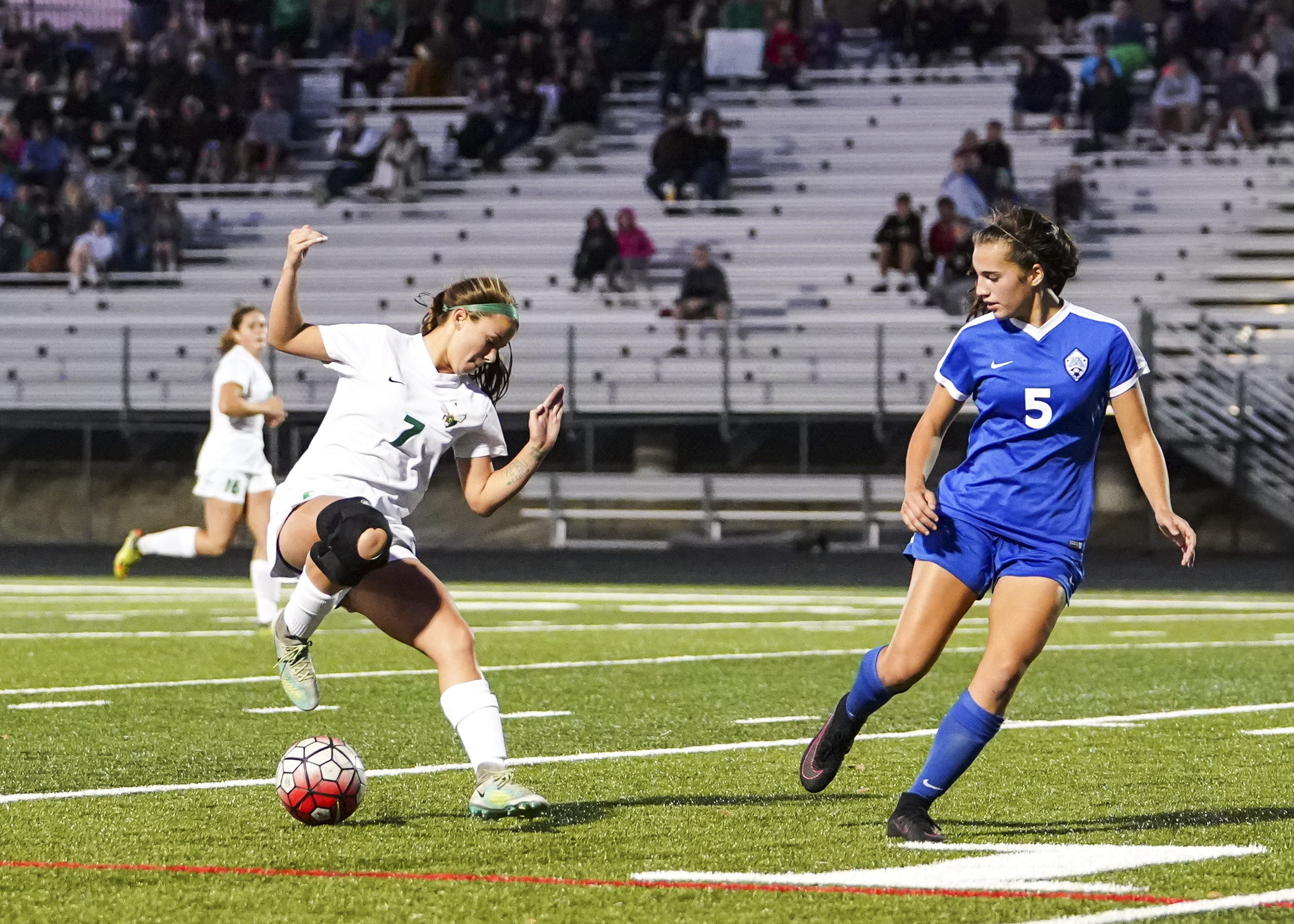 Edina freshman Haley Reeck (7) attacks goal on Minnetonka defender Kayla Mahabadi (5) in the first half. Reeck would later score the game winning goal in double overtime for a 1-0 victory over Minnetonka at Shakopee West Junior High School.