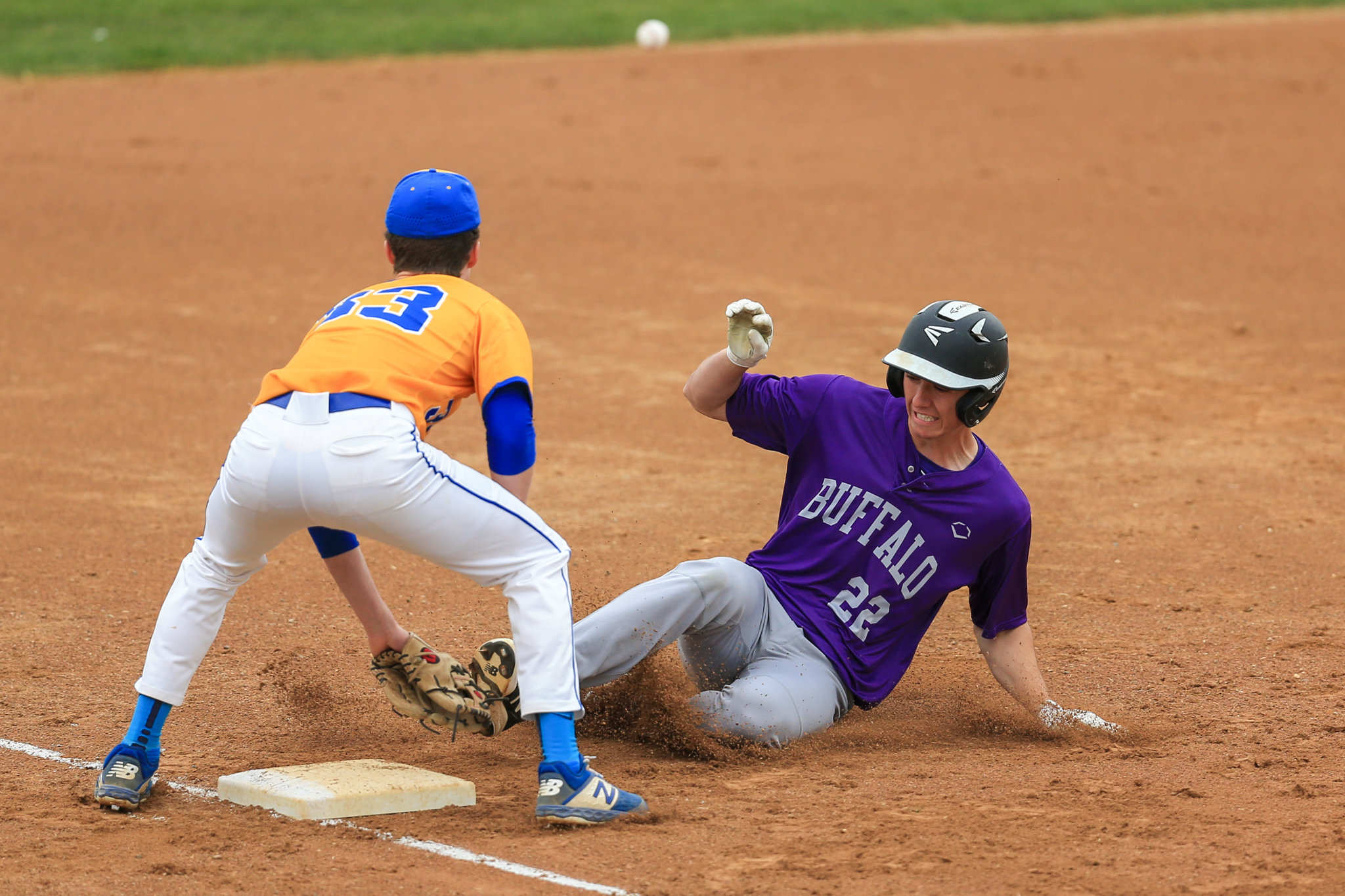 Buffalo's Cole LaPlante (22) slides safely into third base on a first-inning triple against St. Michael-Albertville Friday evening. LaPlante went 3-for-4 with two home runs in the Bison's 10-5 loss in St. Michael. Photo by Jeff Lawler, SportsEngine