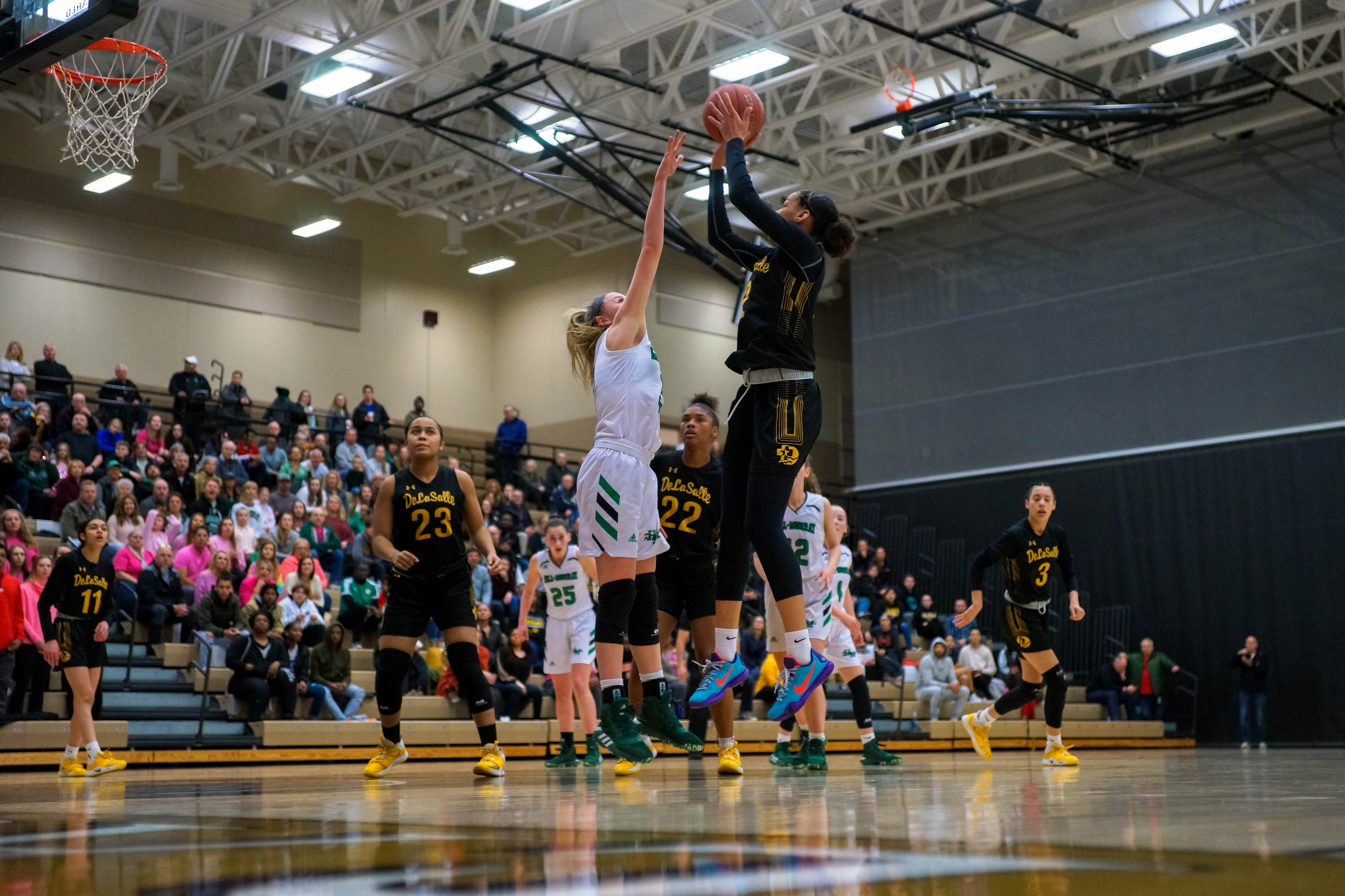 DeLaSalle took one more step closer to defending its state title from last season with a 62-31 section championship victory over Hill-Murray on March 5. Photo by Korey McDermott, SportsEngine