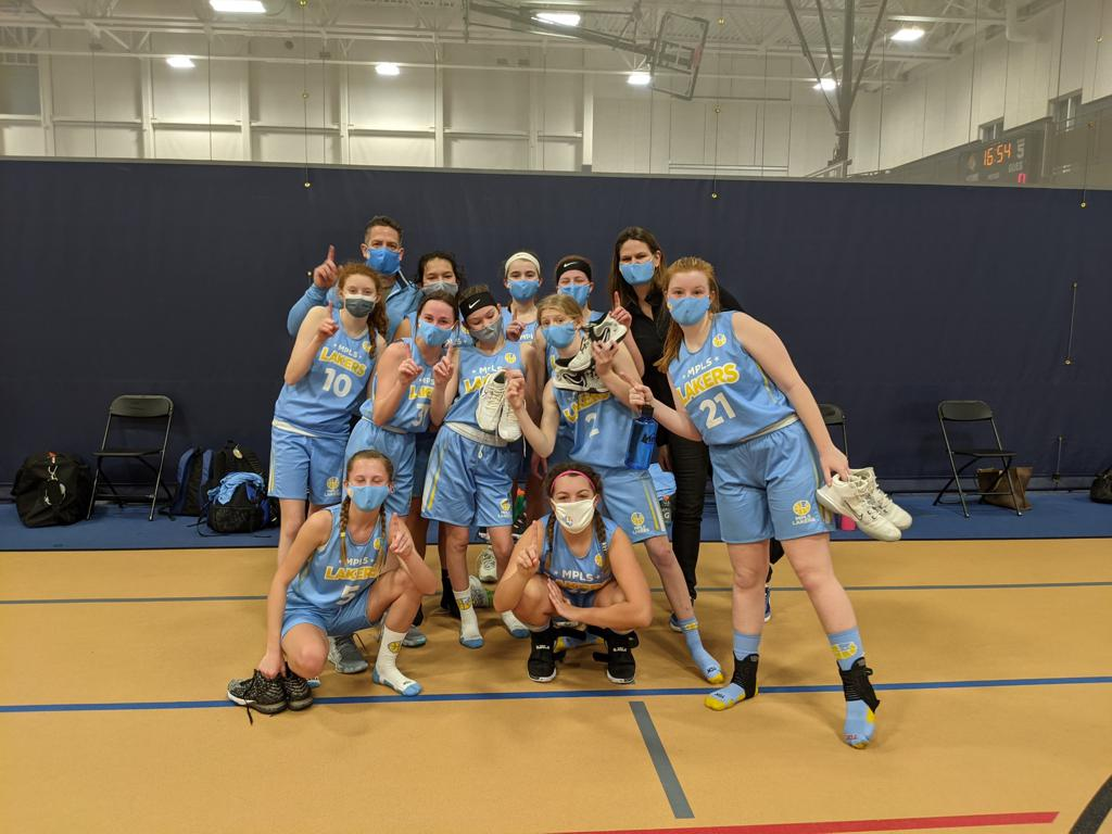 Mpls Lakers Youth Traveling Basketball Program Inc Girls 7th Grade Gold pose after becoming the Champions at the Orono Spartan Classic in Orono, MN
