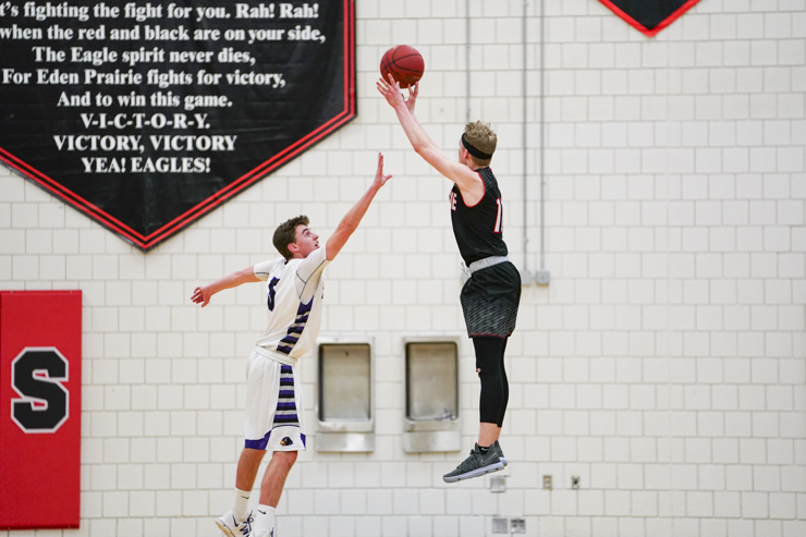 Eden Prairie sophomore Drake Dobbs (11) raises above Chaska senior Matt Eliason (5) for a knock-down three-pointer early in the second half as Eden Prairie wins 74-62. Photo by Travis Ellison, SportsEngine