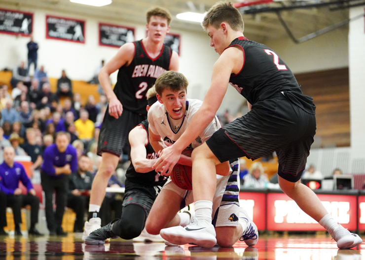 Chaska senior Matt Eliason (5) fights with Eagles senior Kyler Kluge (2) for a lose ball late in the second half as Chaska loses 74-62. Photo by Travis Ellison, SportsEngine
