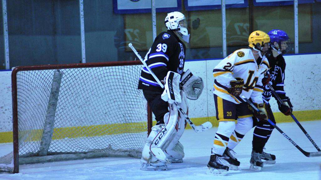 Dom Basse (#39) stood tall for the Eagles, saving all 26 shots he faced in Gonzaga's 1-0 victory over Loyola Academy in a Purple Puck semifinal game on Saturday at Ft. Dupont Ice Arena.