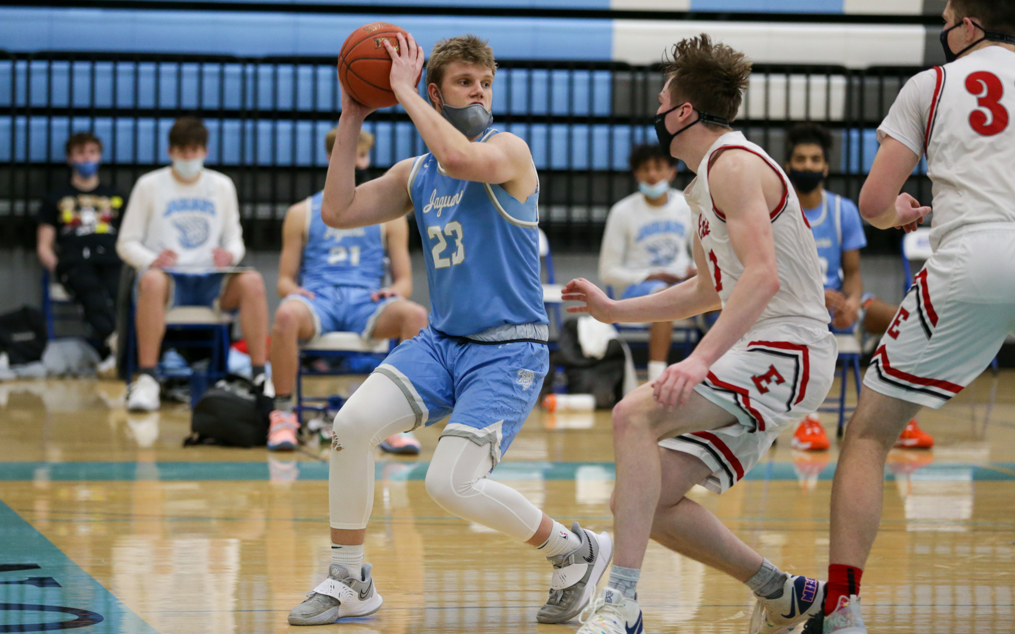 Bloomington Jefferson's Sam Wanzek (23) looks for room under the basket against Duluth East Thursday night. Wanzek had 15 points in the Jaguars' 63-54 loss to the visiting Greyhounds. Photo by Jeff Lawler, SportsEngine