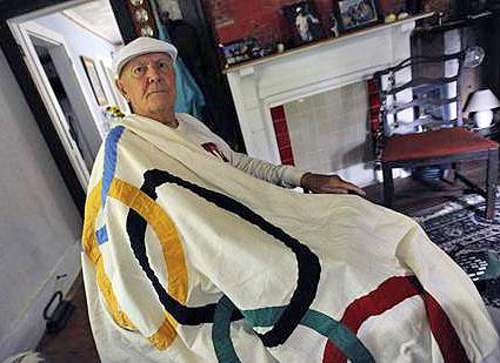 Frank Havens with Olympic Flag