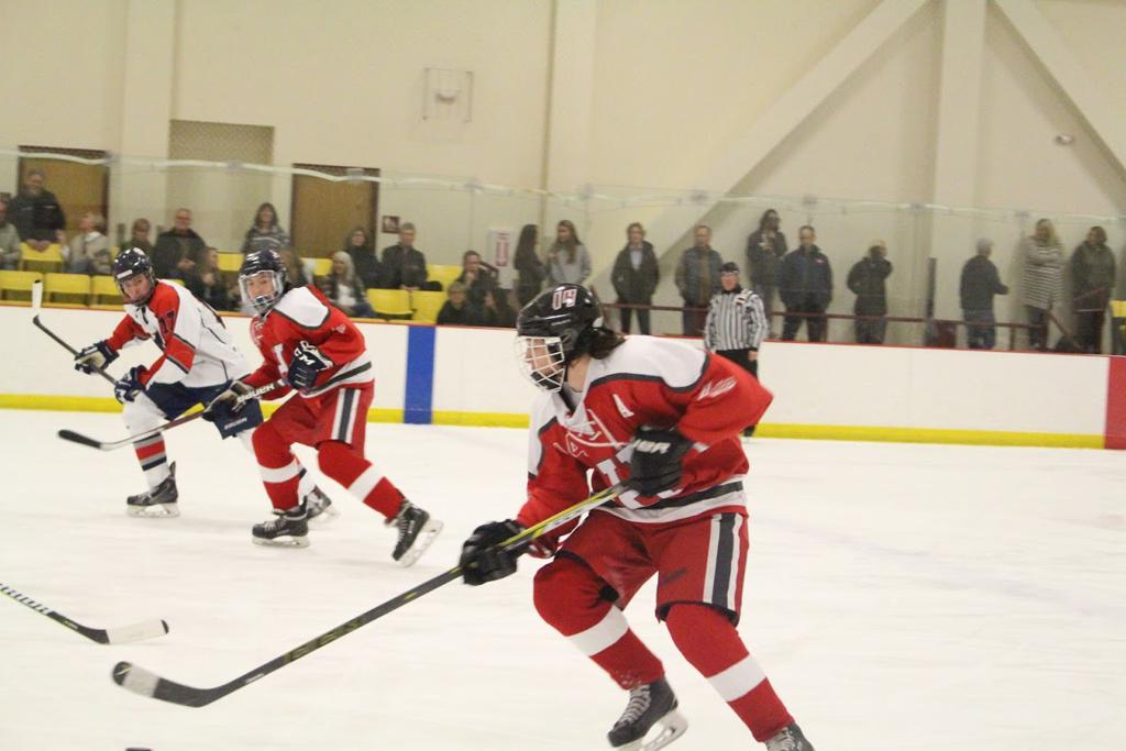 Nick and Kory DiPonio drive into the offensive zone vs Kent Denver
