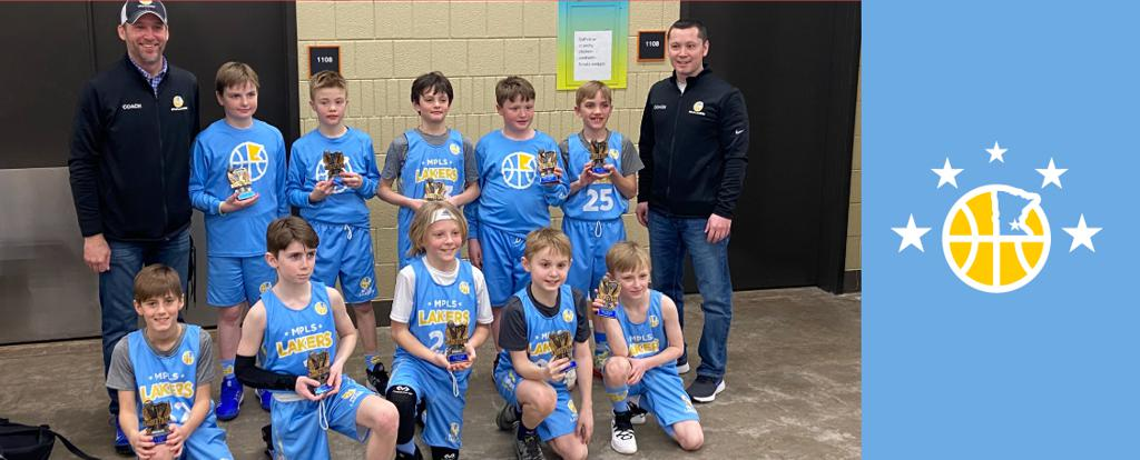 Mpls Lakers Youth Traveling Basketball Program Inc Boys 4th Grade Gold pose with their Trophies after becoming the Champions at the St Paul Winter Shootout tournament in St Paul, MN