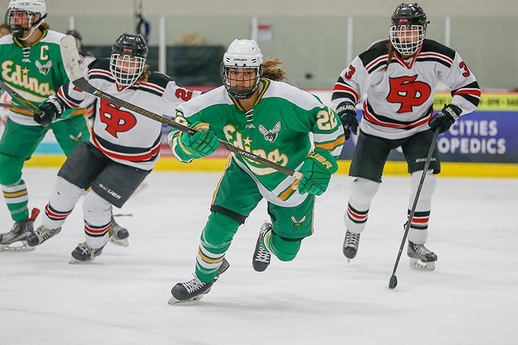 Edina senior Aliyah Lance (22) broke away from the Eden Prairie defense in the third period, when she had a goal and an assist to spark the Hornets' victory. Photo by Mark Hvidsten, SportsEngine
