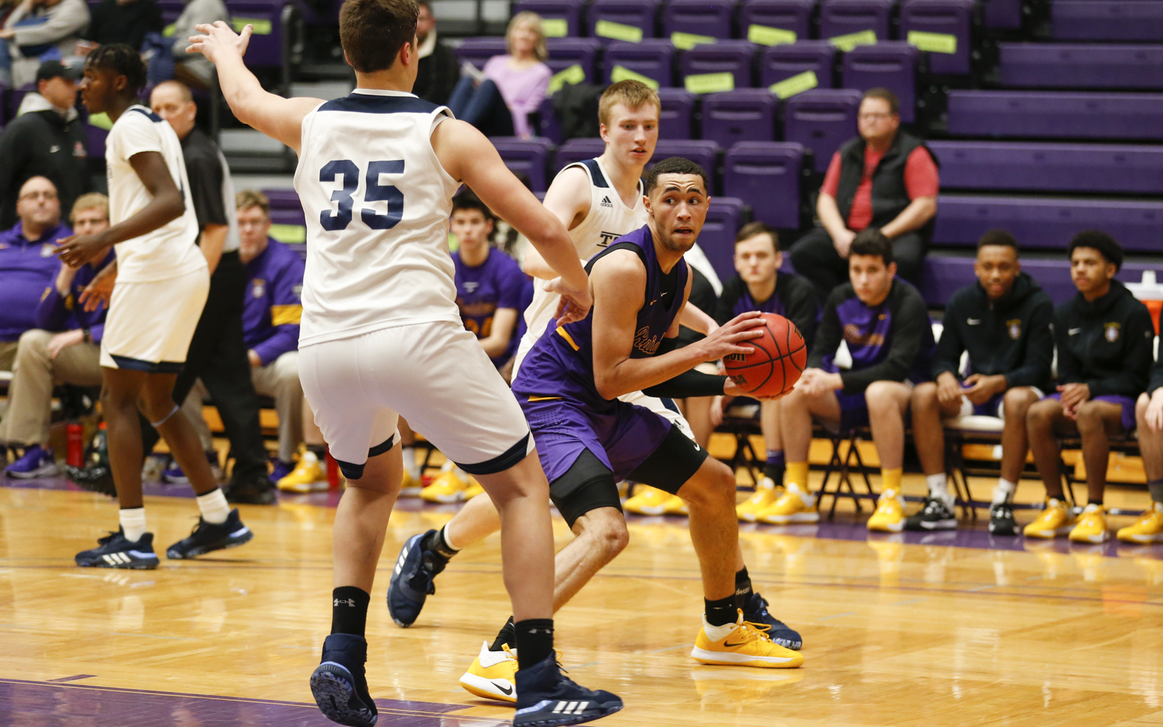 Cretin-Derham Hall's J'Vonne Hadley (2) looks for a passing lane against Totino-Grace Saturday night. Hadley had 23 points in the Raiders' 64-54 victory over the Eagles at the University of St. Thomas.  Photo by Jeff Lawler, SportsEngine