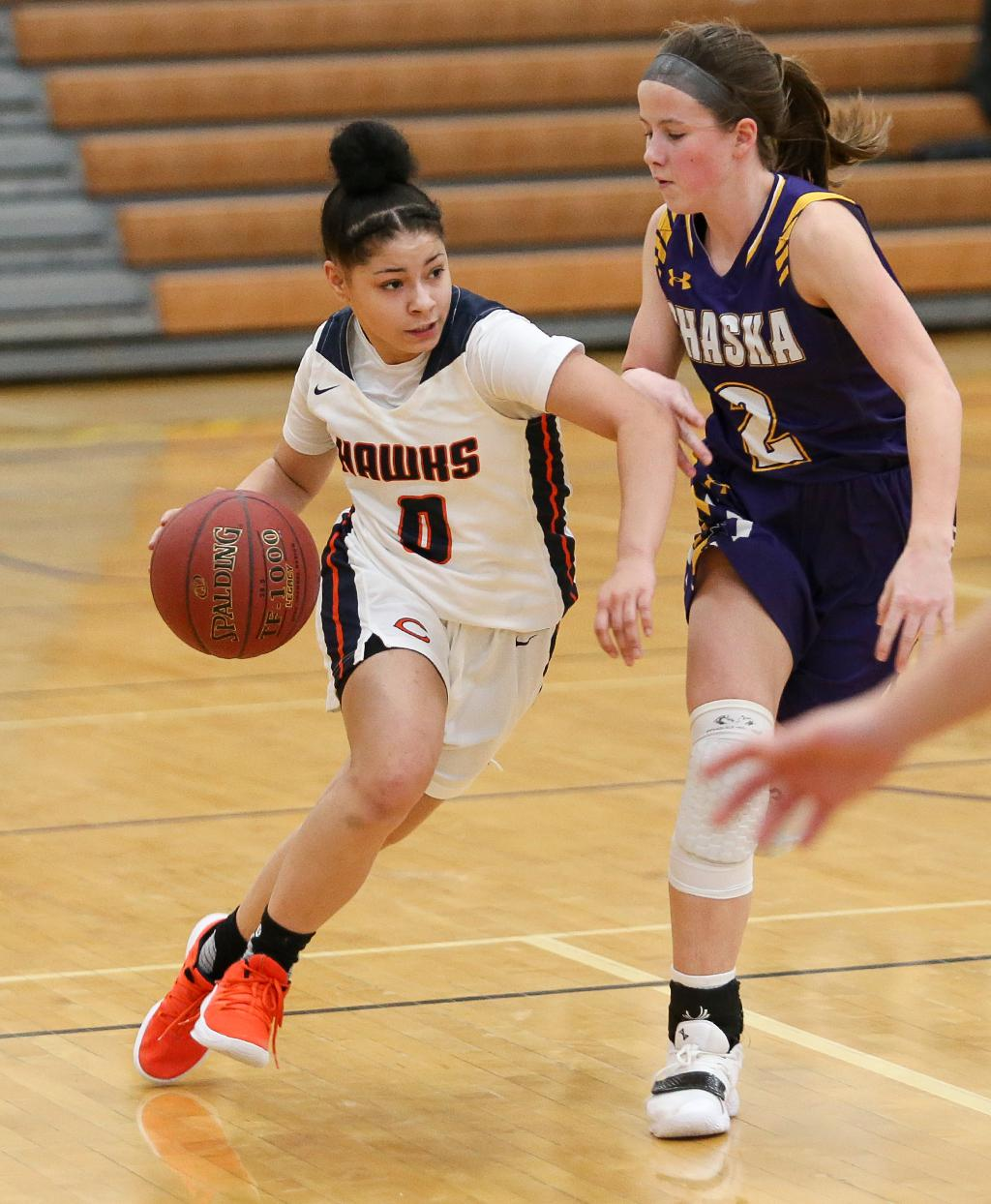 Jayla Reliford (0) carries the ball past defender Kennedy Sanders (2).  Reliford scored 11 points as Cooper held on for the 75-70 win over Chaska. Photo by Cheryl Myers, SportsEngine